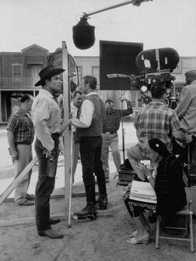 """Actor Clint Walker Standing with His Stand-In Clyde Howdy on the Set of """"Cheyenne"""" by Allan Grant"""