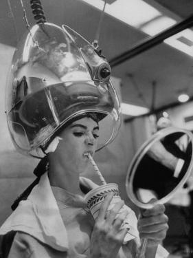 Actress Millie Perkins Making Faces at Herself in Mirror While Getting Hair Done in Beauty Salon by Allan Grant