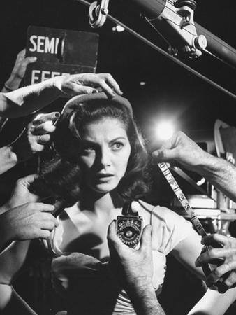 Actress Pier Angeli, Surrounded by Hands From Hair Stylist, Dresser, and Cameraman on MGM Movie Set