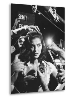 Actress Pier Angeli, Surrounded by Hands From Hair Stylist, Dresser, and Cameraman on MGM Movie Set by Allan Grant