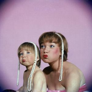 Actress Shirley MacLaine and Daughter Sachi Parker Pouting with String of Pearls on Their Heads by Allan Grant