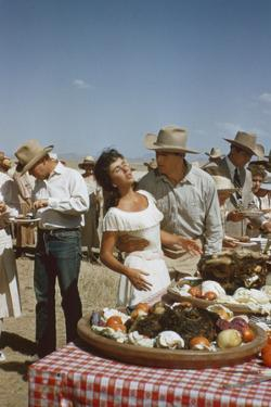 American Actor Rock Hudson Holds Actress Elizabeth Taylor While Filming 'Giant', Marfa, Texas, 1956 by Allan Grant
