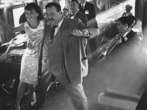 """Ann Warner, with Jackie Gleason in Lounge Car of """"Gleason Express"""" Announcing His Return to Tv by Allan Grant"""