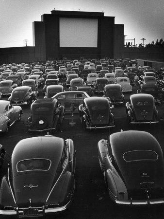 Cars Filling Lot at New Rancho Drive in Theater at Dusk Before the Start of the Feature Movie