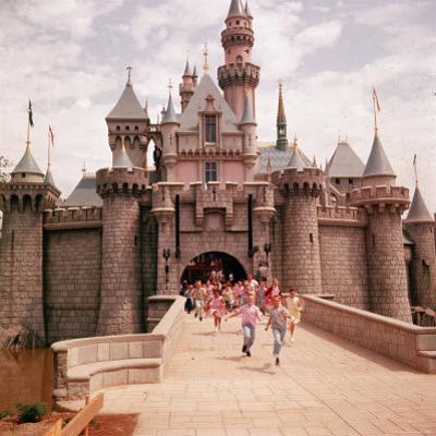 Children Running Through Gate of Sleeping Beauty's Castle at Walt Disney's Theme Park, Disneyland