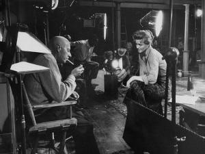 "Director Howard Hawks Conferring with Actress Angie Dickinson on Set for ""Rio Bravo"" by Allan Grant"