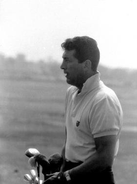 Entertainer Dean Martin Playing Golf by Allan Grant