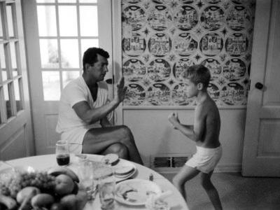 Entertainer Dean Martin Sparring with His Son at Home
