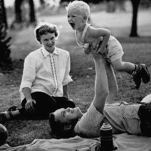 Father Playing with His Child During a Picnic by Allan Grant