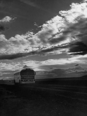 Greyhound Bus Driving Down Highway 30