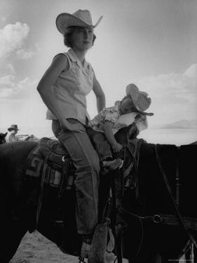 Jean Anne Evans, 14 Month Old Texas Girl, Falling Asleep on Horse with Her Mother by Allan Grant