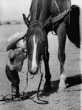 Jean Anne Evans, 14 Month Old Texas Girl Kissing Her Horse by Allan Grant