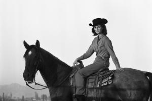 Lee Archer, 24, Riding a Horse at O.B. Llyod Stables in Scottsdale, Arizona, October 1960 by Allan Grant