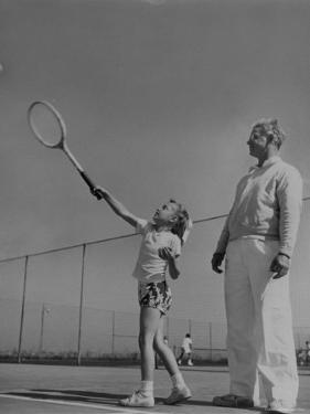 Tennis Teacher Wilbur Folsom Watching the Service of Young Anne Perkins by Allan Grant