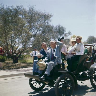 Walt Disney Riding on Automobile at Disneyland. Anaheim, California 1955