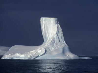 Penola Strait, Pleneau Island, Columnar Iceberg in Evening Light, Antarctica