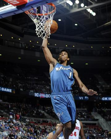 Washington Wizards v Detroit Pistons: Nick Young and Jason Maxiell by Allen Einstein