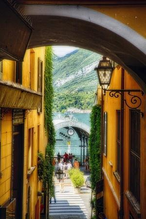 https://imgc.allpostersimages.com/img/posters/alley-with-a-lake-view-bellagio-lake-como-italy_u-L-Q1ASFMA0.jpg?p=0