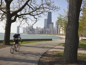 Cyclist by Lake Michigan Shore, Gold Coast District, Chicago, Illinois, USA by Amanda Hall