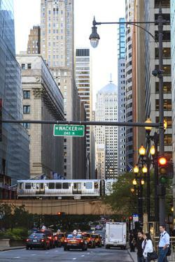 L Train on Elevated Track Crosses South Lasalle Street in the Loop District, Chicago, Illinois, USA by Amanda Hall