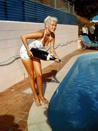American Actress Jayne Mansfield with a Bottle of Champagne, Near a Swimming Pool, 1956-1957