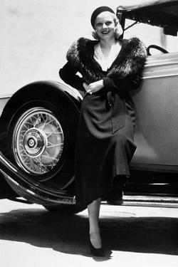 American Actress Jean Harlow (1911-1937) Posing Near a Car