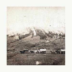 American Civil War: Three Horse-Drawn Covered Wagons in the Foreground. Soldiers Marching in Format