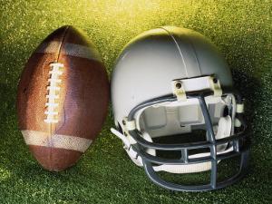 American Football Helmet and a Football