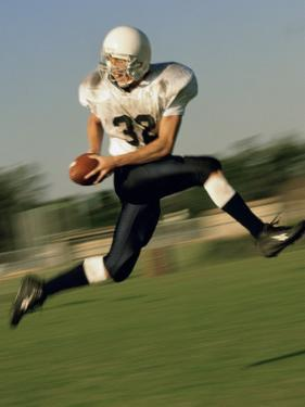 American Football Player Running on a Field