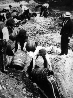 A Us Federal Agent Oversees the Destruction of Beer Kegs During the American Prohibition Era… by American Photographer