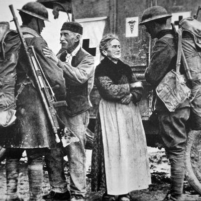 French Peasants Greet Two Heavily-Laden Americans, 1917