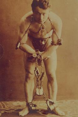 Harry Houdini in chains, c.1899 by American Photographer
