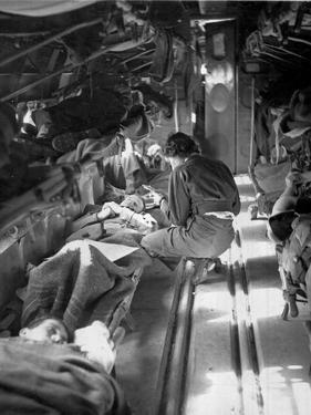 Miss Mary Smith of South Carolina Treating Patients During Flight to North by American Photographer