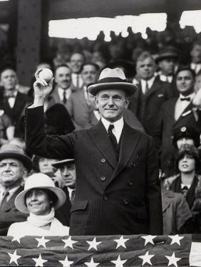 President Calvin Coolidge (1872-1933) Throws Out the First Ball of the 1924 World Series, 1924 by American Photographer