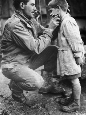 American Soldier Walton Trohon Cleaning the Face of a Young French Orphan During WWII