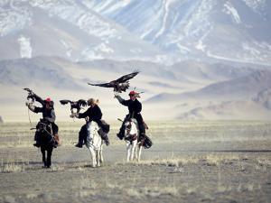 Eagle Hunters Dalai Khan, Takhuu Grandfather, Son Kook Kook, Golden Eagle Festival, Mongolia by Amos Nachoum