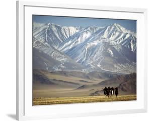 Four Eagle Hunters in Tolbo Sum, Golden Eagle Festival, Mongolia by Amos Nachoum