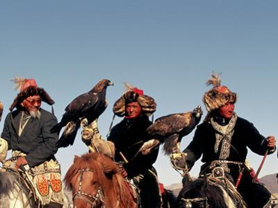 Hunters from Sagsai Sum, Bechik, Tek and Khalbek, Golden Eagle Festival, Mongolia by Amos Nachoum