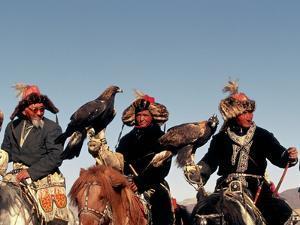 Hunters from Sagsai Sum, Bechik, Tek and Khalbek, Golden Eagle Festival, Mongolia by Amos Nachoum