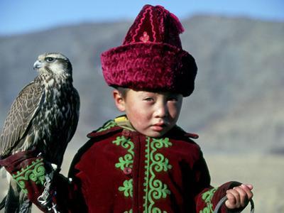 Young Boy Holding a Falcon, Golden Eagle Festival, Mongolia