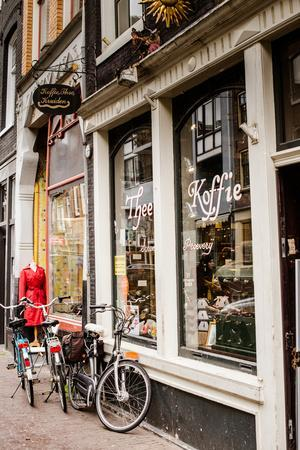 https://imgc.allpostersimages.com/img/posters/amsterdam-storefront_u-L-Q11UR620.jpg?p=0