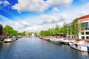 Amsterdam with Canal in the Downtown,Holland. by Brian K