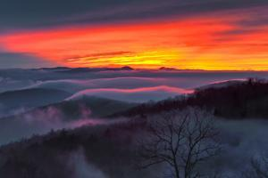 A Dramatic Fiery Sunset and Low Clouds Over the Blue Ridge Mountains by Amy & Al White & Petteway