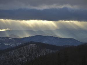 Sunlight Streams Through Storm Clouds over the Blue Ridge Mountains by Amy & Al White & Petteway