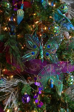 A Christmas Tree Decorated with Iridescent Blue and Purple Ornaments by Amy and Al White and Petteway