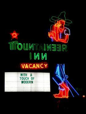 A Stereotypical Mountain Man Graces the Neon Sign of a Local Landmark by Amy and Al White and Petteway