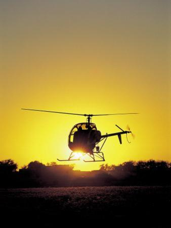 Helicopter with Sun Setting by Amy And Chuck Wiley/wales