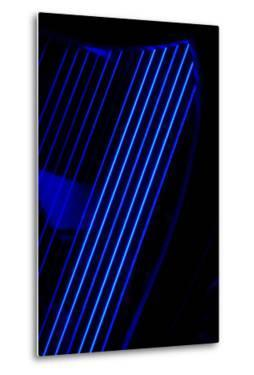 Blue Light Shining Through the Strings of a Celtic Harp on Stage before a Concert by Amy White and Al Petteway