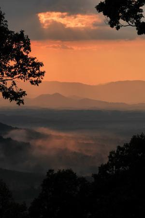 Sunset Colors a View of a Distant Mountain Range after a Rainstorm by Amy White and Al Petteway