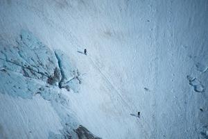 An Aerial View of Hikers in a Vast Patagonia Landscape of Snow and Ice